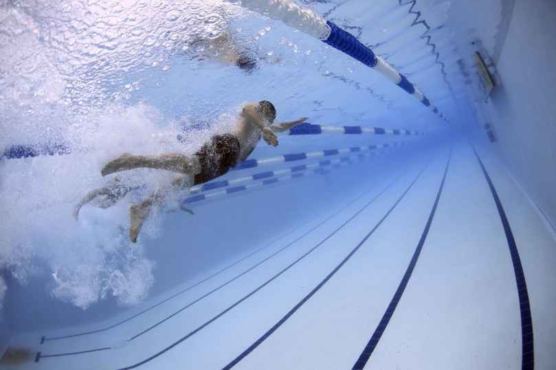 swimmers-swimming-race-competition-56837.jpeg